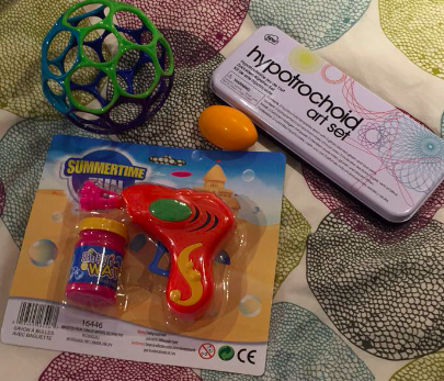 O-Ball, Spiral art set, Silly Putty, and a Bubble Gun